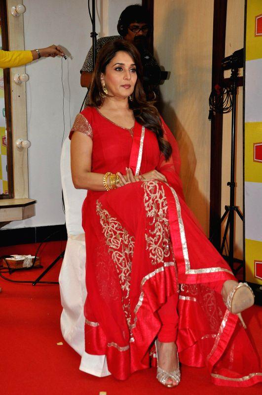 Actor Madhuri Dixit endorse Mahakosh refined Soyabean oil, in Mumbai, on Aug 14, 2014. Ruchi Soya Industries Limited (Ruchi Soya) announces Madhuri Dixit as the brand ambassador for Mahakosh Edible ..