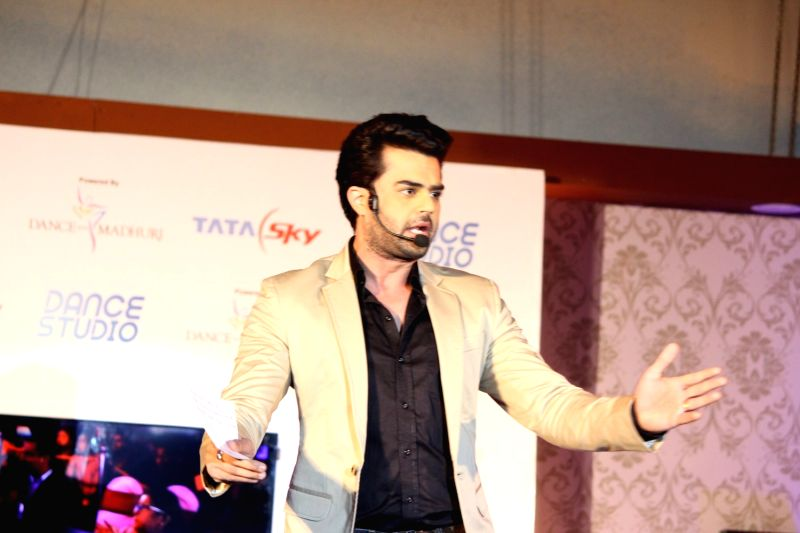 Actor Manish Paul during the launch of Tata Sky's new interactive service 'Dance Studio' in association with RnM Moving Picture in Mumbai on  Dec 10,  2015 - Manish Paul