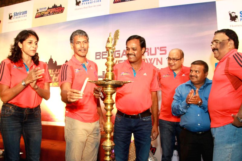 Actor Milind Soman and Rith Abraham during press conference to announce `Bengaluru Marathon' in Bangalore on June 27, 2014. - Milind Soman