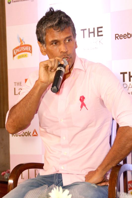 Actor Milind Soman during a press conference to launch 2nd Pinkathon 2014 in New Delhi on July 31, 2014. - Milind Soman