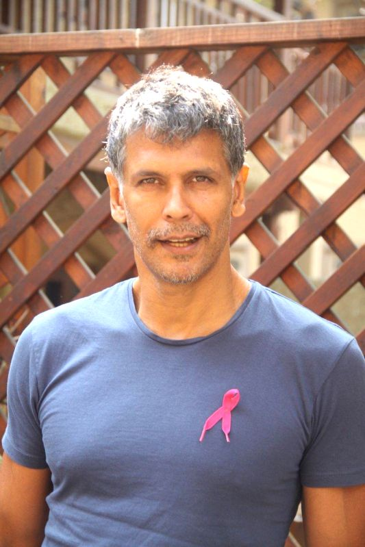 Actor Milind Soman extends his support to HCG Pinkathon 2013, during a press conference to announce the completion of 10,000 registered participants in Mumbai on 27th November 2013. - Milind Soman