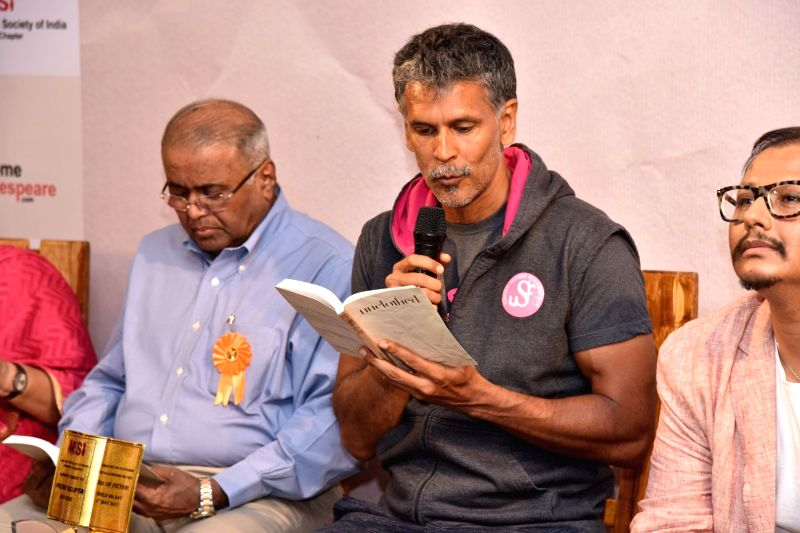 Actor Milind Soman reading expects from `Unclothed` book during the launch, in Mumbai, on May 31, 2017. - Milind Soman