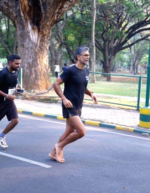 Actor Milind Soman running barefoot during Cult 10k run, in Bengaluru on May 13, 2017. - Milind Soman