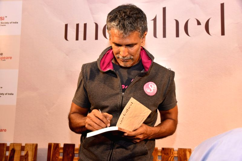 Actor Milind Soman signing a book for a fan during the launch of Probir Sengupta`s book `Unclothed` in Mumbai, on May 31, 2017. - Milind Soman