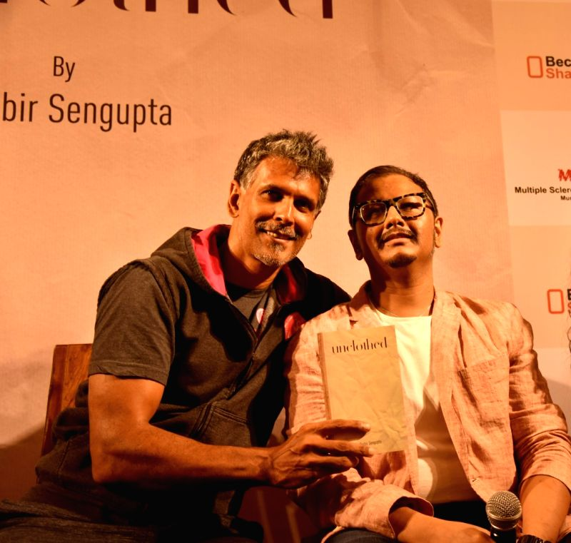 Actor Milind Soman with author Probir Sengupta during the launch of his book `Unclothed` in Mumbai, on May 31, 2017. - Milind Soman