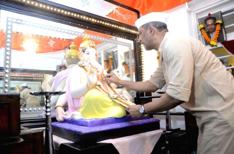 Actor Nana Patekar worships lord Ganesh in his home during Ganesh Festival in Mumbai on Aug 29, 2014.