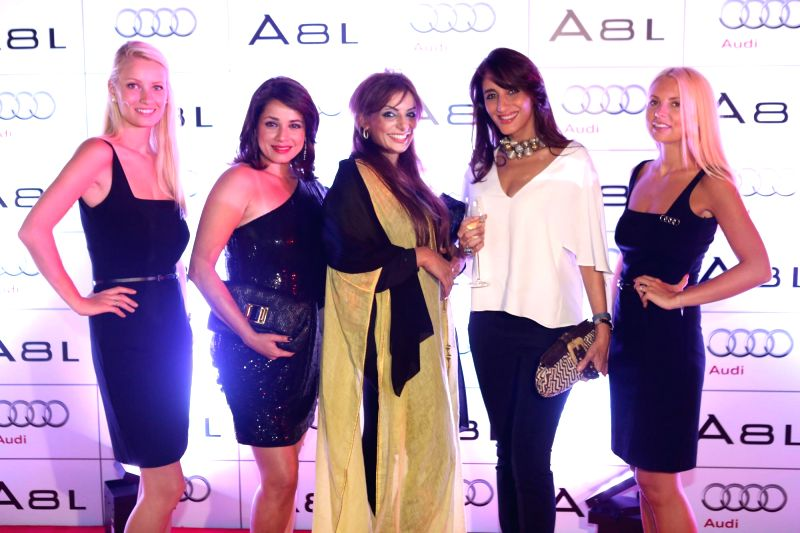 Actor Neelam Kothari, Sama Bin Karam and Farah Khan Ali during the launch of Audi A8L in Dubai. - Neelam Kothari and Farah Khan Ali