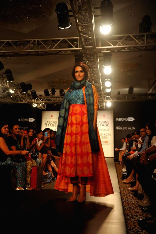 Actor Neha Dhupia displays the creation of fashion designer Swati Vijayvargie during the Lakme Fashion Week (LFW) Winter/ Festive 2014 in Mumbai, on Aug. 21, 2014. - Neha Dhupia