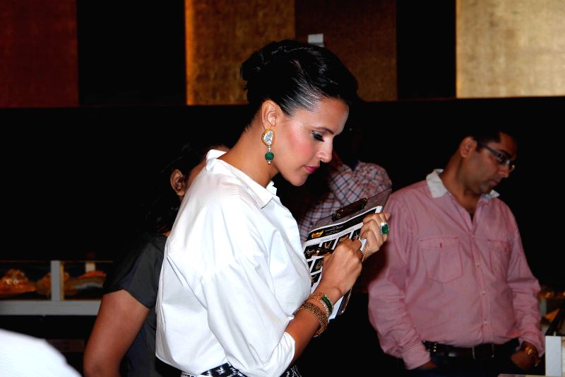Actor Neha Dhupia during the jury meets for the 10th annual Gemfields and Nazraana Retail Jeweller India Awards 2014 at Hotel Sahara Star in Mumbai on July 3, 2014. - Neha Dhupia