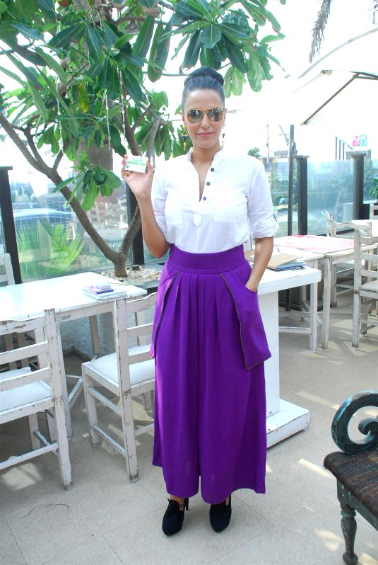 Actor Neha Dhupia unveils India`s first vegan discount card, PETA`s V-Card organised by People for the Ethical Treatment of Animals (PETA) in Mumbai, on November 20, 2014. - Neha Dhupia