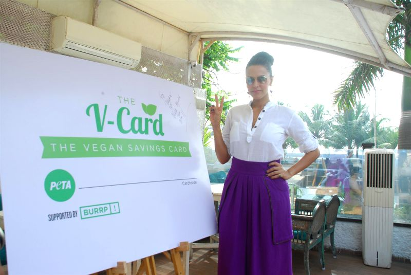 Actor Neha Dhupia unveils India`s first vegan discount card, PETA`s V-Card organised by People for the Ethical Treatment of Animals (PETA) in Mumbai, on November 20, 2014.