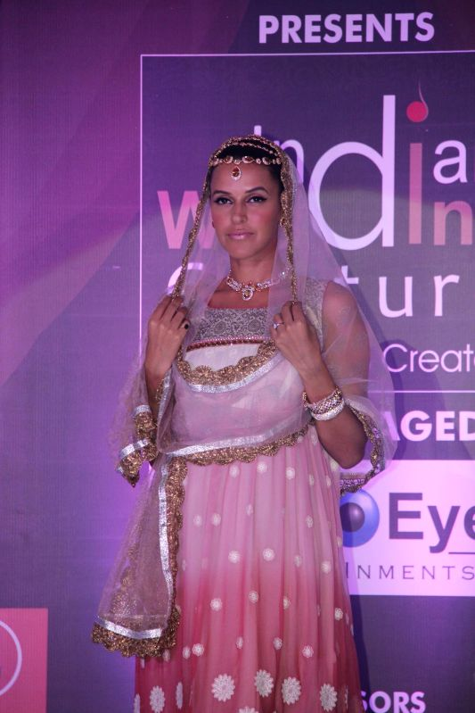 Actor Neha Dhupia walks on the ramp as a showstopper to display Geetanjali`s design during the Indian Wedding couture show at Viviana Mall in Thane, Mumbai on June 29, 2014.