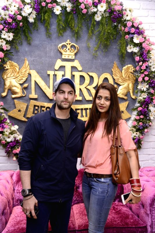 Actor Neil Nitin Mukesh along with his wife Rukmini Sahay during Praboddh Davkharey, MD, Nittro Gym birthday party celebrations, on May 29, 2017. - Neil Nitin Mukesh