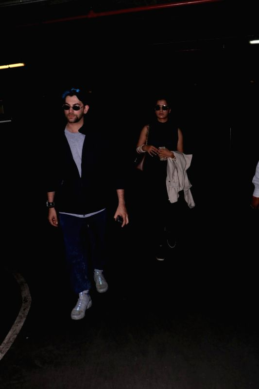 Actor Neil Nitin Mukesh along with his wife Rukmini Sahay spotted at Chhatrapati Shivaji Maharaj International Airport in Mumbai, on June 10, 2017. - Neil Nitin Mukesh
