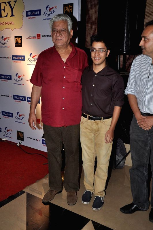 Actor Om Puri along with his son Ishaan Puri during the screening of Hollywood film The Hundred-Foot Journey in Mumbai on August 7, 2014.