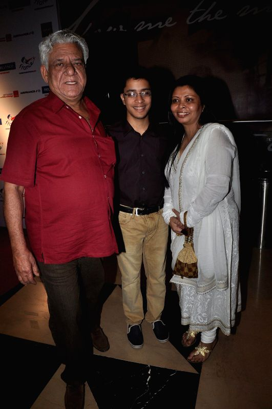 Actor Om Puri along with his wife Nandita Puri and son Ishaan Puri during the screening of Hollywood film The Hundred-Foot Journey in Mumbai on August 7, 2014.