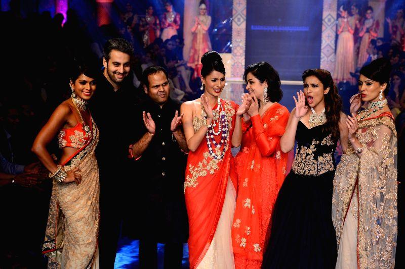 Actor Parineeti Chopra displays the creation for Aks by Birdhichand Ghanshyamdas Jewels during the India International Jewellery Week (IIJW) in Mumbai, on July 16, 2014. - Parineeti Chopra