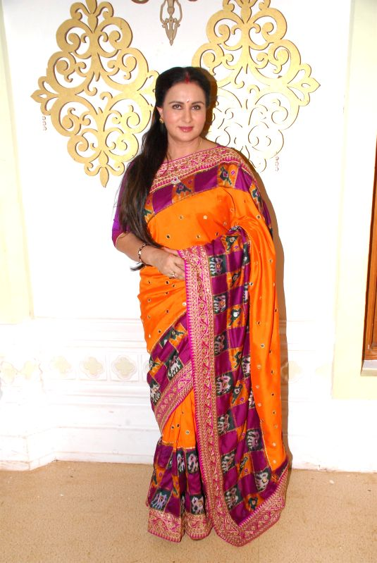 Actor Poonam Dhillon celebrates the Raksha Bandhan festival in Mumbai on August 5, 2014.