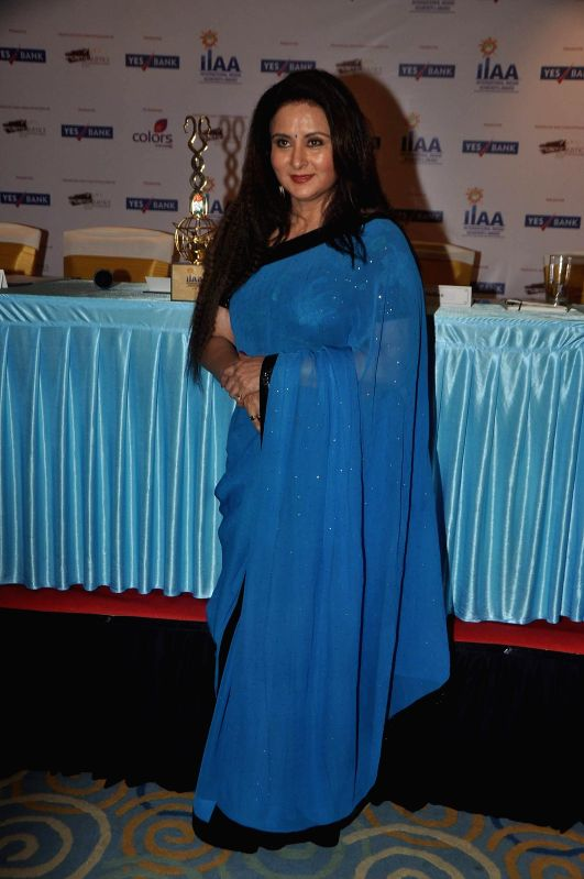 Actor Poonam Dhillon unveiling the International Indian Achievers Award's (IIAA) trophy in Mumbai on July 21, 2014. - Poonam Dhillon