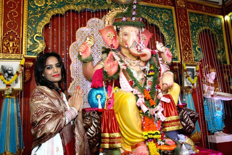 Actor Poonam Pandey offer prayers at Andhericha Raja Ganesh Pandal in Mumbai, on Sep. 01, 2014. - Poonam Pandey