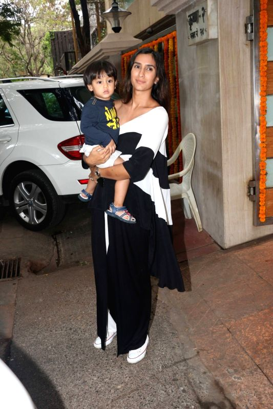 Actor Pragya Yadav with her son during Tussar Kapoor son Laksshay`s first birthday party in Mumbai on June 1, 2017. - Pragya Yadav and Tussar Kapoor