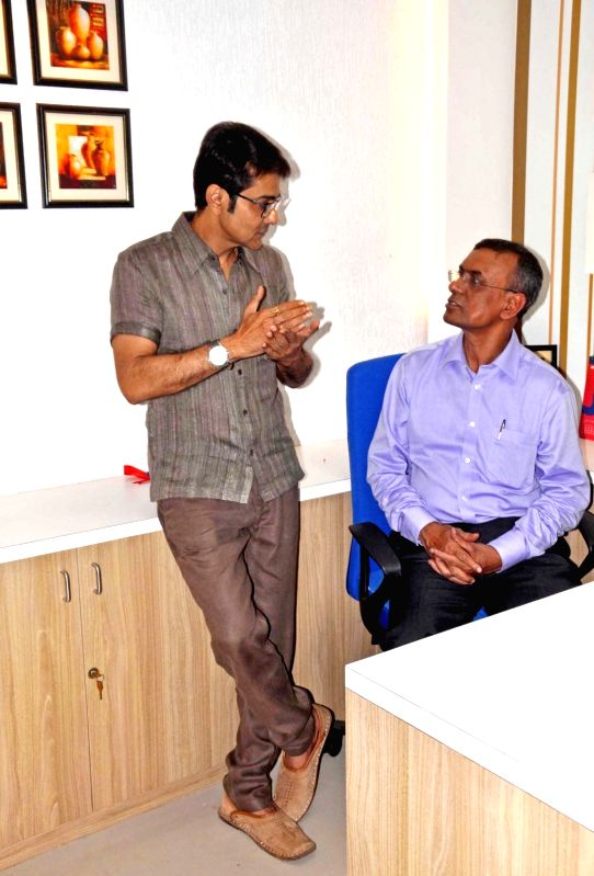 Actor Prasenjit Chatterjee interacts with Bandhan Bank Managing Director Chandra Shekhar Ghosh during the inauguration of Bandhan Bank's 700th branch in Kolkata on Aug 8, 2016. - Prasenjit Chatterjee and Chandra Shekhar Ghosh