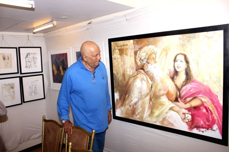 Actor Prem Chopra during the inauguration of a art exhibition, in Mumbai on May 27, 2016. - Prem Chopra