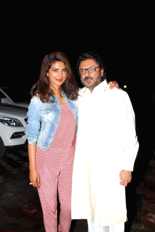 Actor Priyanka Chopra and filmmaker Sanjay Leela Bansali during her birthday celebration in Mumbai on July 25, 2014. - Priyanka Chopra