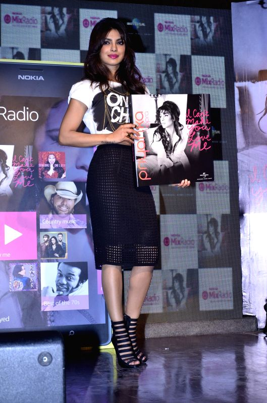 Actor Priyanka Chopra during her tie up with Nokia MixRadio and launch of her new album I Can't Make You Love Me in Mumbai, on May 5, 2014.