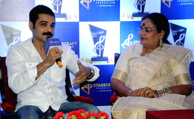 Actor Prosenjit Chatterjee and singer Usha Uthup during a press conference regarding `Stagecraft 2014 awards` in Kolkata on Aug 7, 2014. - Prosenjit Chatterjee