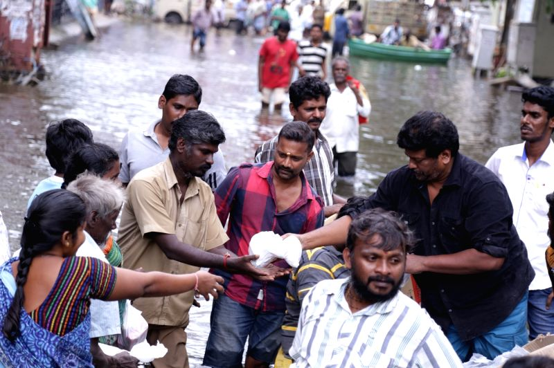 Actor Radhakrishnan Parthiban involved in flood relief activities in Chennai.