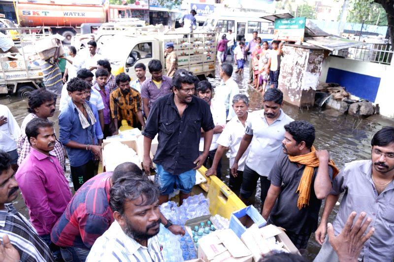 Actor Radhakrishnan Parthiban involved in flood relief activities in Chennai.