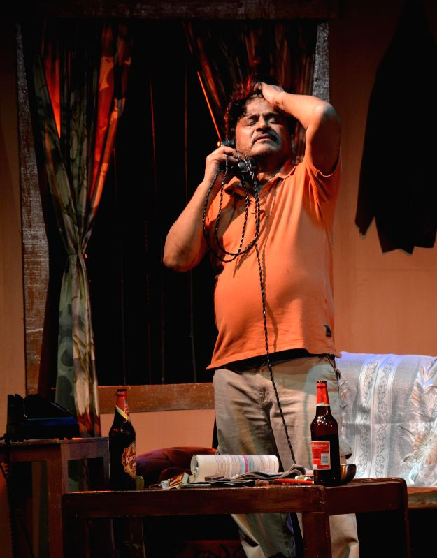 Actor Raghubir Yadav acts in a play - `Piano` which was staged during ongoing Natasurya Drama Festival in Guwahati on Aug 7, 2014. - Raghubir Yadav