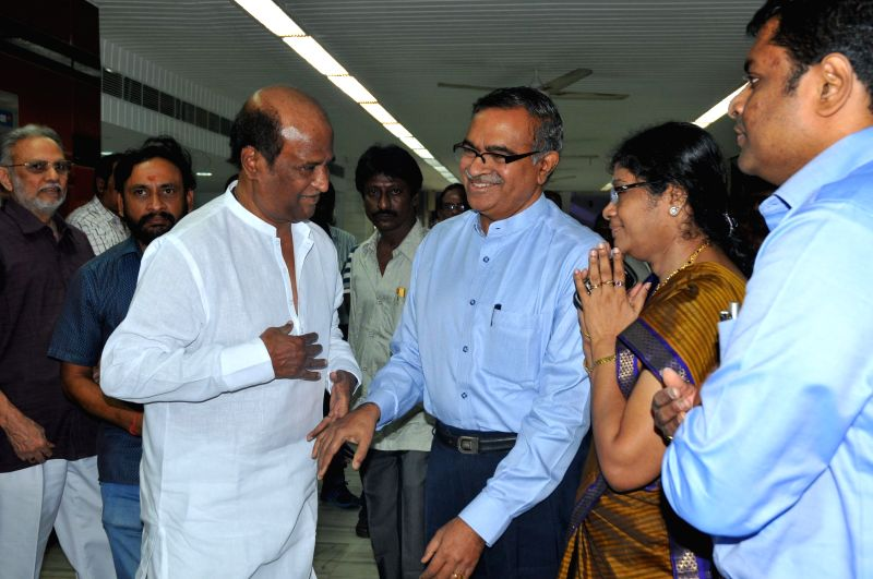 Actor Rajinikanth arrives to pay tribute to Tamil filmmaker K. Balachander during a programme organised to perform rituals and rites on the 13th day of his death in Chennai, on Jan 4, 2015.