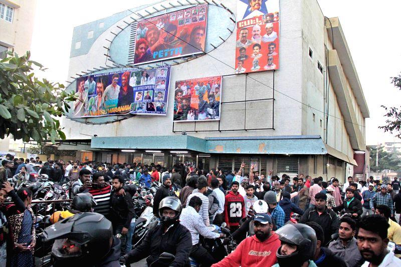 "Actor Rajinikanth's fans throng cinema halls after his film ""Petta"" hit the theaters today, in Bengaluru, on Jan 10, 2019. - Rajinikant"