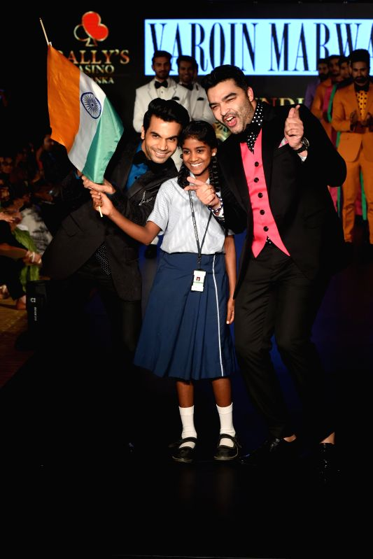Actor Rajkumar Rao with designer Varoin Marwah during the lndia`s first Men`s Fashion Week - ILSW, in Bengaluru on 16 Aug 2015. - Rajkumar Rao