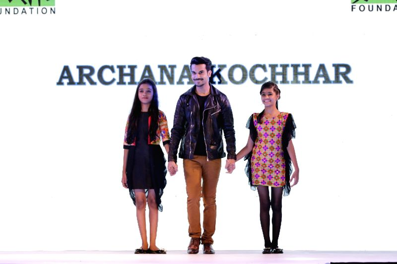 Actor Rajkummar Rao walks the ramp during for 9th edition of charity fashion show organized by Smile Foundation in Mumbai, on August 2, 2015. - Rajkummar Rao
