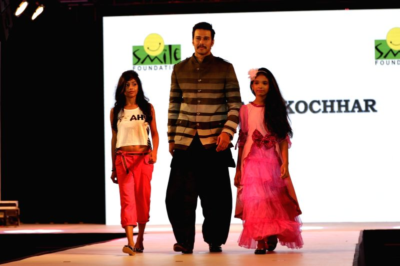 Actor Rajneesh Duggal (1).JPG (435K) walks the ramp during for 9th edition of charity fashion show organized by Smile Foundation in Mumbai, on August 2, 2015. - Rajneesh Duggal