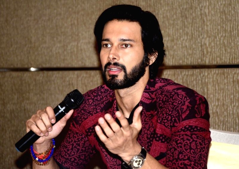 "Actor Rajneesh Duggal addresses a press conference to promote his upcoming historical drama ""Aarambh"" in Bhopal on June 9, 2017. - Rajneesh Duggal"