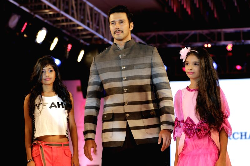 Actor Rajneesh Duggal walks the ramp during for 9th edition of charity fashion show organized by Smile Foundation in Mumbai, on August 2, 2015. - Rajneesh Duggal