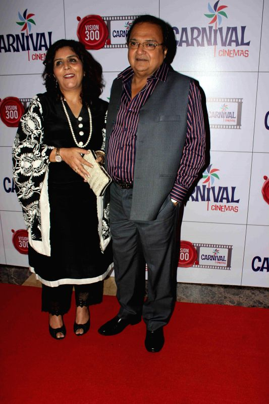 Actor Rakesh Bedi with his wife during the launch of Carnival Cinemas in Mumbai on July 10, 2014. - Rakesh Bedi