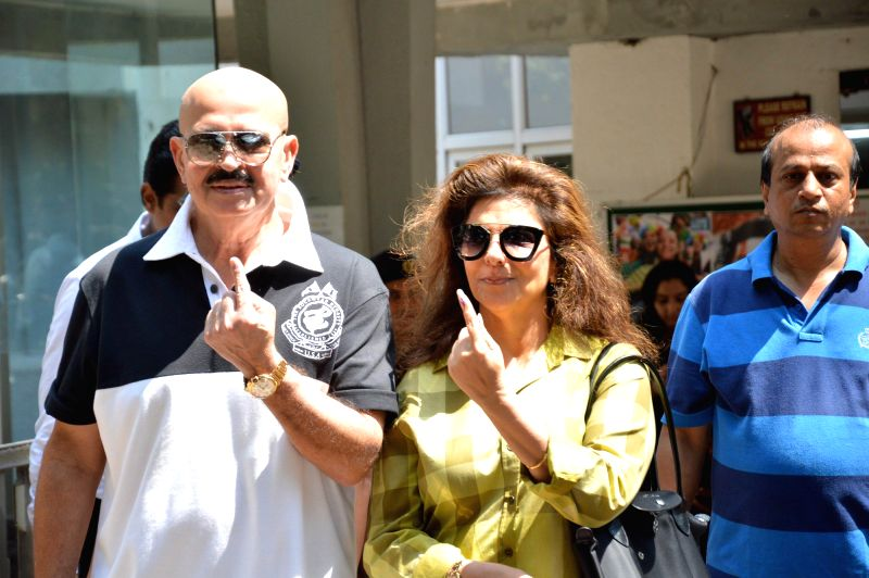 Actor Rakesh Roshan with wife Pinky Roshan shows their fore fingers marked with phosphorous ink after casting his vote at a polling booth during the sixth phase of 2014 Lok Sabha Polls in Mumbai on .. - Rakesh Roshan