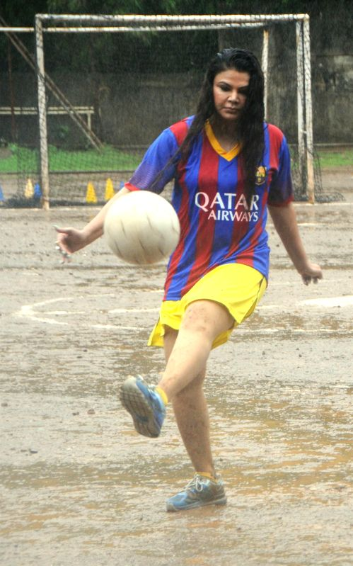 Actor Rakhi Sawant play football with students to create awareness of football, in Mumbai on July 10, 2014.