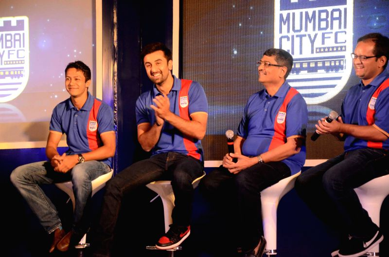 Actor Ranbir Kapoor with Bimal Parekh during the Mumbai City FC football club team logo launch in Mumbai on Aug. 30, 2014. - Ranbir Kapoor