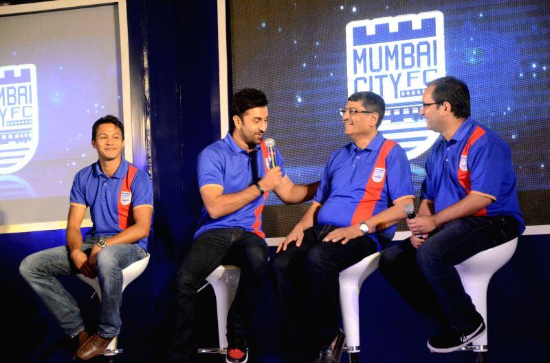 Actor Ranbir Kapoor with Bimal Parekh during the Mumbai City FC football club team logo launch in Mumbai on Aug. 30, 2014. - Ranbir Kapoor