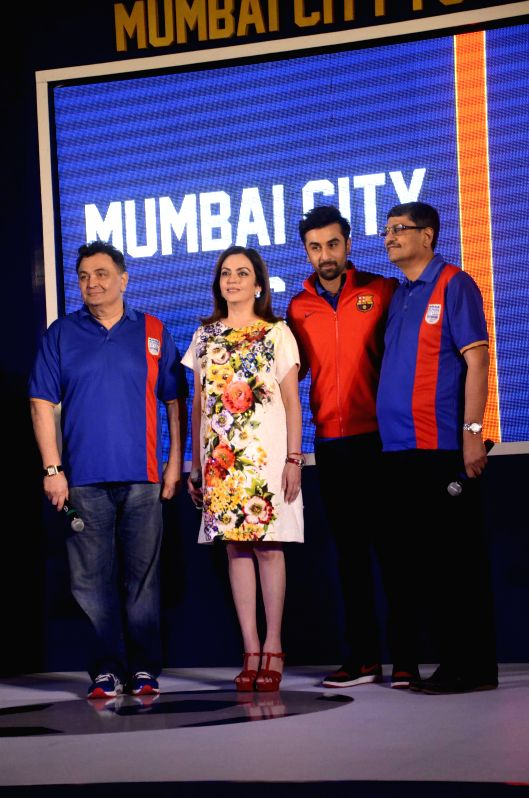 Actor Ranbir Kapoor with his father Rishi Kapoor, Neeta Ambani and Bimal Parekh during the Mumbai City FC football club team logo launch in Mumbai on Aug. 30, 2014. - Ranbir Kapoor, Rishi Kapoor and Neeta Ambani