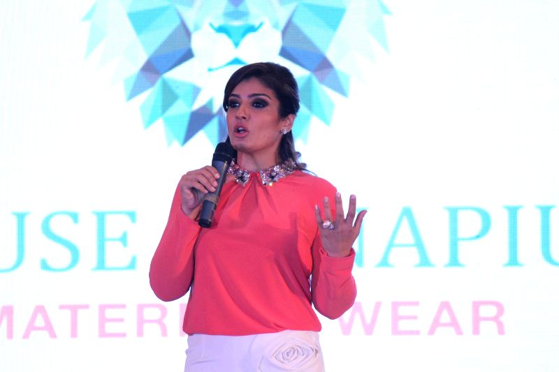 Actor Raveena Tandon during the launch of radiation safe maternity wear by House of Napius in Mumbai, on March 26, 2015.