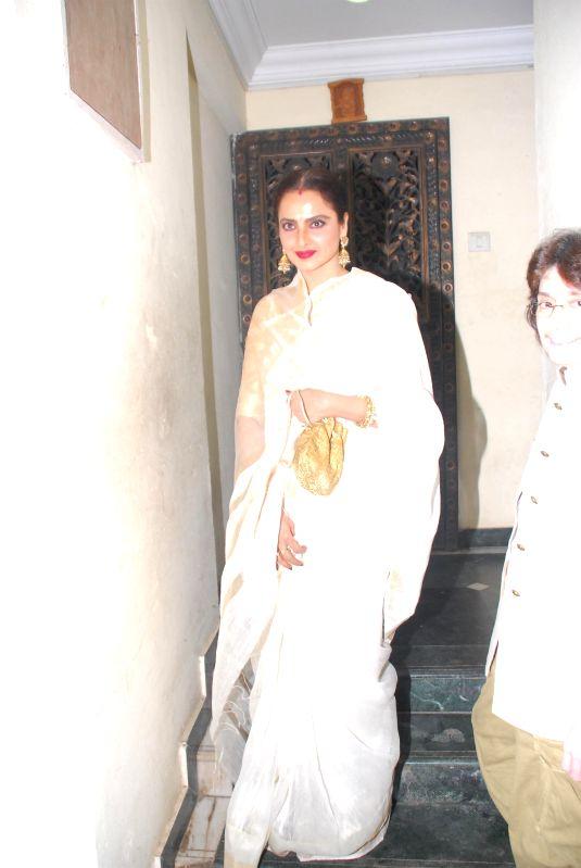 Actor Rekha during the birthday celebration of actor Priyanaka Chopra in Mumbai on July 25, 2014. - Rekha and Priyanaka Chopra
