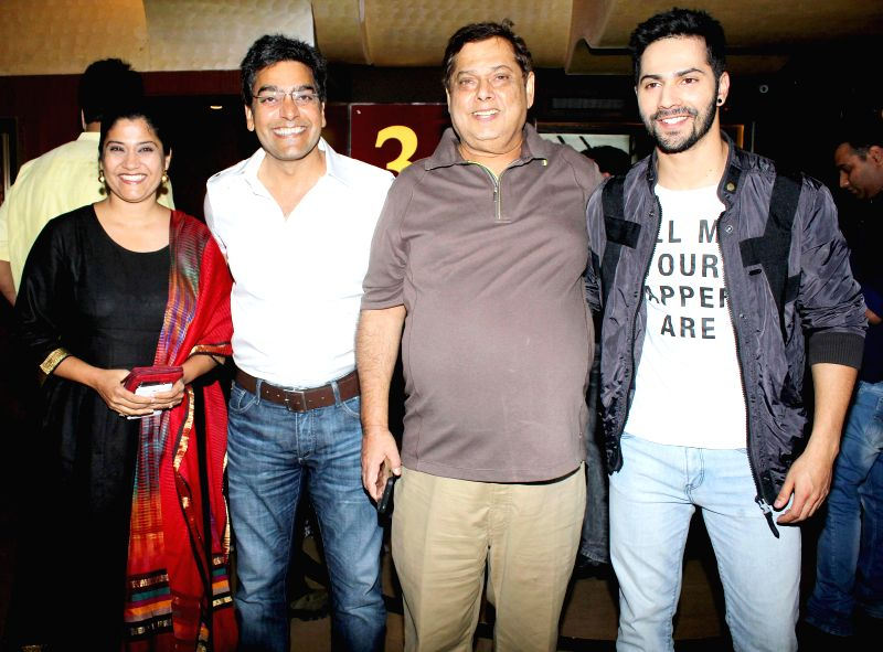 Actor Renuka Shahane with husband Ashutosh Rana, filmmaker David Dhawan and actor Varun Dhawan during the special screening of film Humpty Sharma ki Dulhania in Mumbai on July 10, 2014. - Renuka Shahane