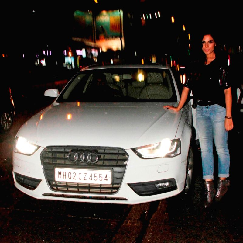 Actor Richa Chadda snapped exclusively posing with her Audi A4 car at Andheri in Mumbai.